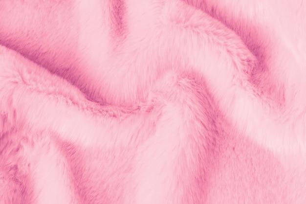 Beschaffenheit des rosa zottigen pelzes. tierische süße weiche textur