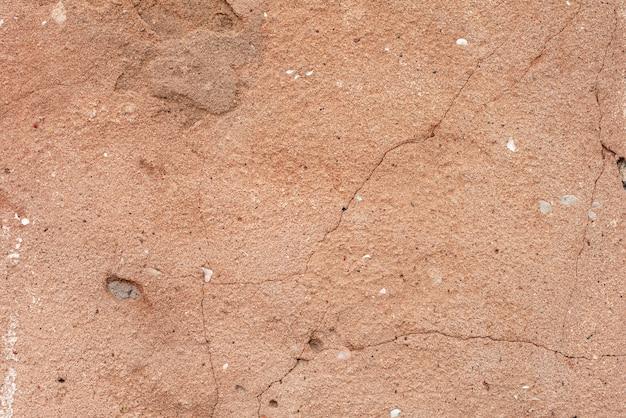 Beschaffenheit einer betonmauer mit sprüngen und kratzern