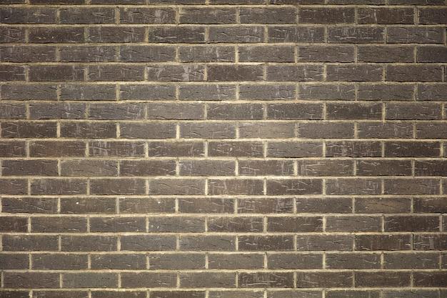 Beschaffenheit eines dunklen backsteinmauerhintergrundes