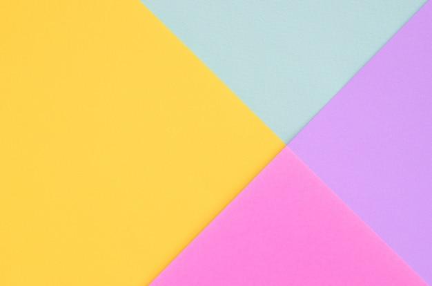 Beschaffenheitshintergrund von modepastellfarben. rosa, veilchen, gelb