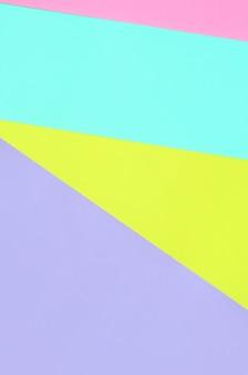 Beschaffenheitshintergrund von modepastellfarben. rosa, violette, gelbe und blaue geometrische musterpapiere.