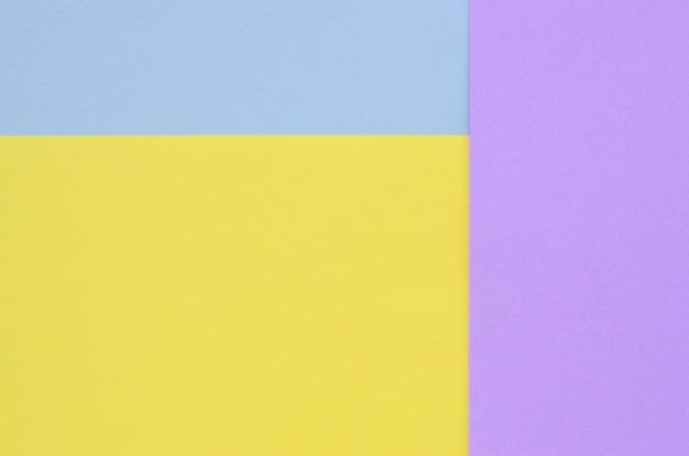 Beschaffenheitshintergrund von modepastellfarben. violett, gelb