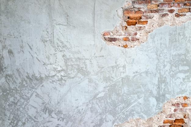 Beschaffenheitshintergrund von zementwänden und von alten ziegelsteinrissen in der wandoberfläche fühlt es sich retro