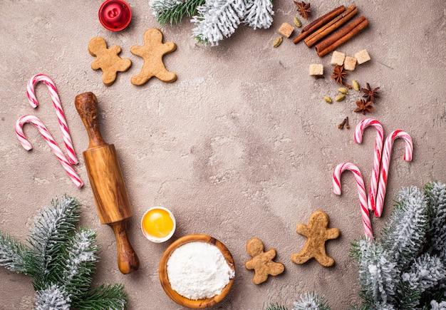 Bestandteile für das backen von weihnachtsplätzchen, runder rahmenhintergrund