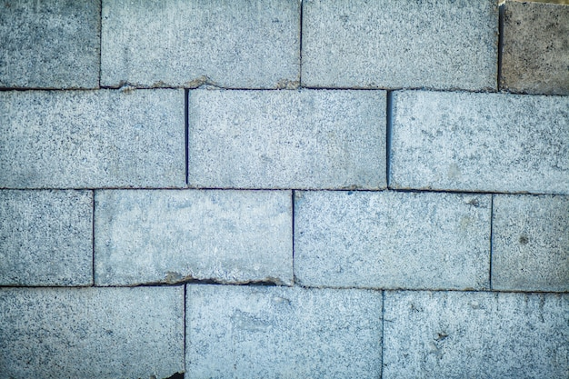 Betonblockwandbeschaffenheit und -hintergrund nahtlos
