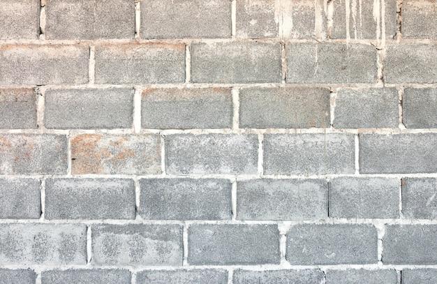 Betonblockwandhintergrund und -beschaffenheit.