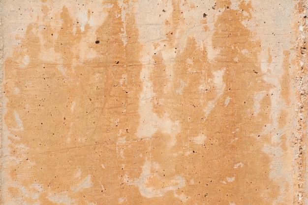 Betonmauerbeschaffenheit mit löchern und flecken