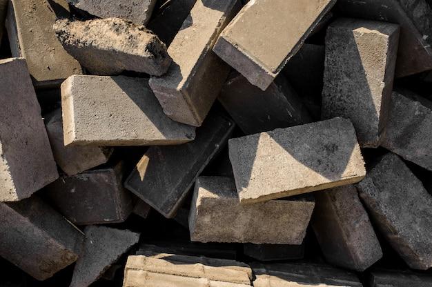 Betonpflasterplatten. hintergrund der pflaster in einer willkürlichen reihenfolge
