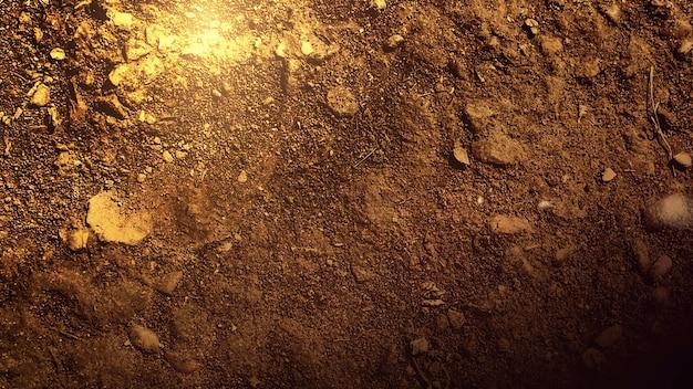 Bewegungssonnenstrahlen und lichteffekt auf bodentextur mit steinen, dunkler filmischer hintergrund. luxuriöse und elegante 3d-darstellung des kinothemas