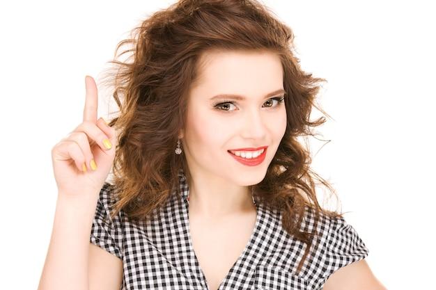Bild der attraktiven teenagerin mit dem finger nach oben