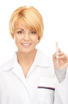 Bild einer attraktiven ärztin mit thermometer
