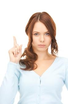 Bild einer attraktiven jungen frau mit dem finger nach oben
