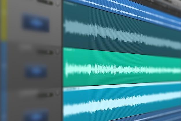 Bild einer mehrspurigen audiowelle auf dem monitor. aufnahme, mischung und mastering im studio..