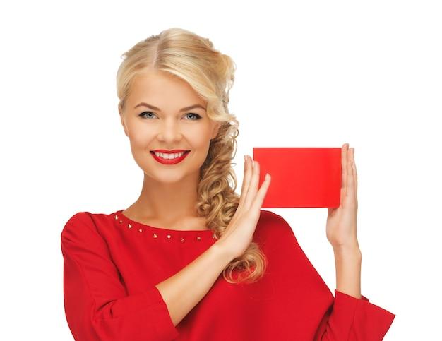 Bild einer schönen frau im roten kleid mit notizkarte