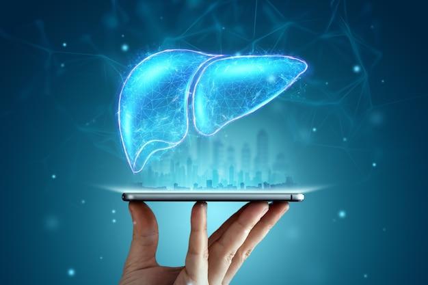 Bild eines leberhologramms über einem smartphone auf einem blauen hintergrund. geschäftskonzept zur behandlung von hepatitis beim menschen, prävention von krankheiten, online-diagnose.