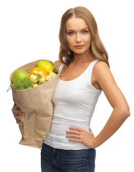 Bild von frau mit einkaufstüte voller früchte