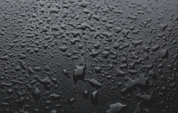 Bild von kleinen wassertropfen auf einem schwarzen hintergrund. strukturierter hintergrund mit wassertropfen. makrofotografie
