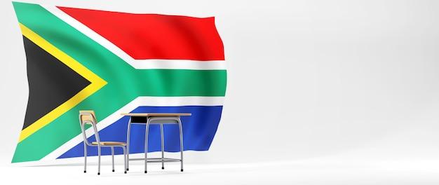 Bildungskonzept. 3d des schreibtisches und der südafrikanischen flagge auf weißem hintergrund.