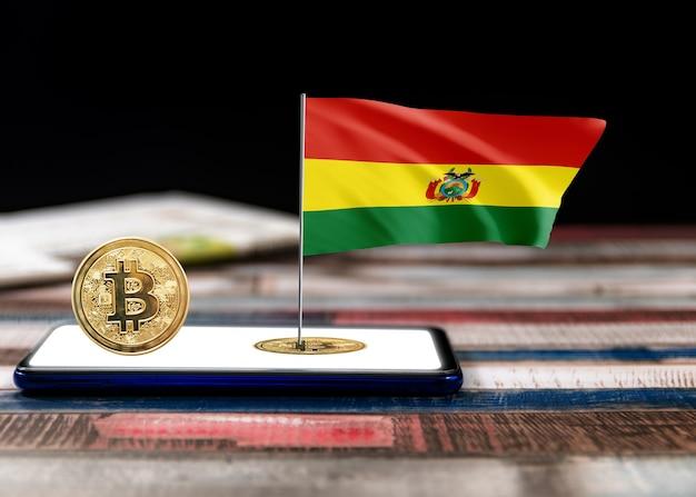 Bitcoin bolivien auf flagge boliviens. bitcoin-nachrichten und rechtslage in bolivien-konzept.