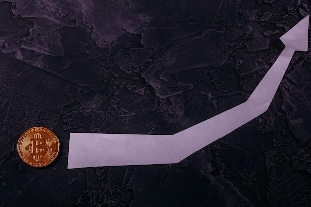 Bitcoin btc auf einem dunklen hintergrund mit dem zeitplan der wachstumsraten