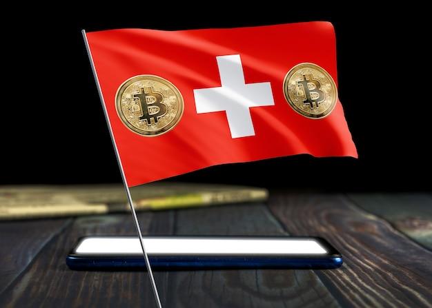 Bitcoin schweiz auf flagge der schweiz. bitcoin-nachrichten und rechtslage in der schweiz konzept.