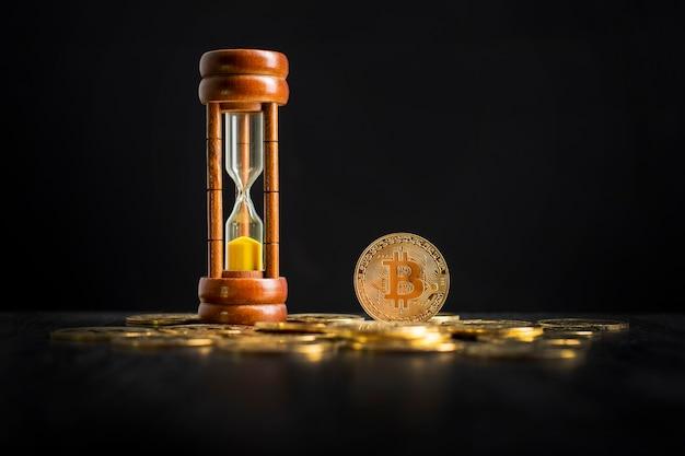 Bitcoin und sanduhr