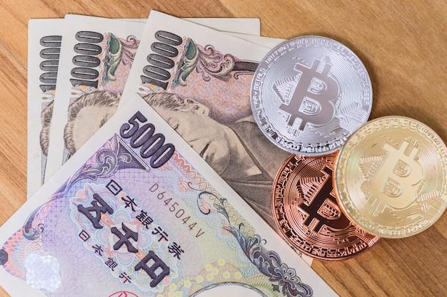 Bitcoin-zahlung mit kryptowährung mit japan-yen-geld.