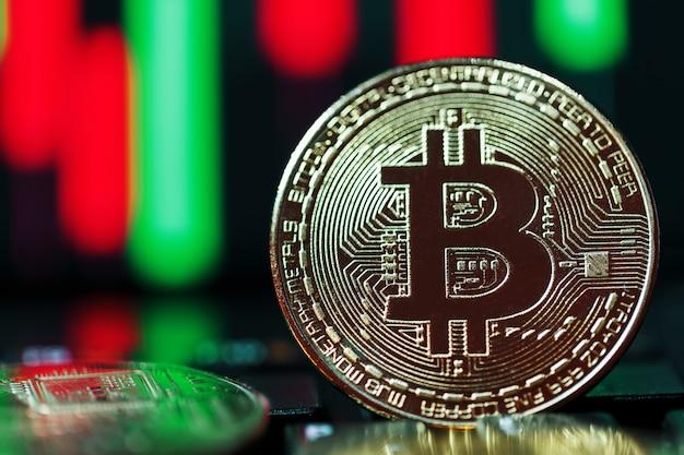 Bitcoins vor dem hintergrund der nahaufnahme von geschäftsdiagrammen.
