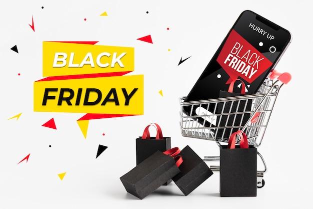 Black friday verkaufsarrangement mit warenkorb und smartphone