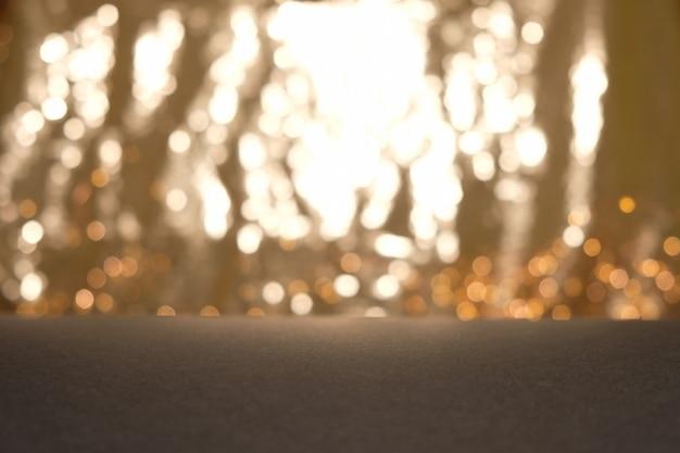 Blackground von abstrakten funkelnlichtern. gold und schwarz. de konzentrierte sich.