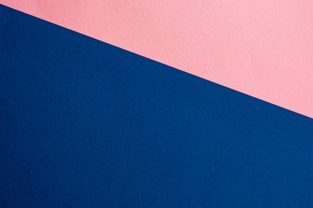 Blätter des hintergrundes des farbigen papiers. blau rosa.