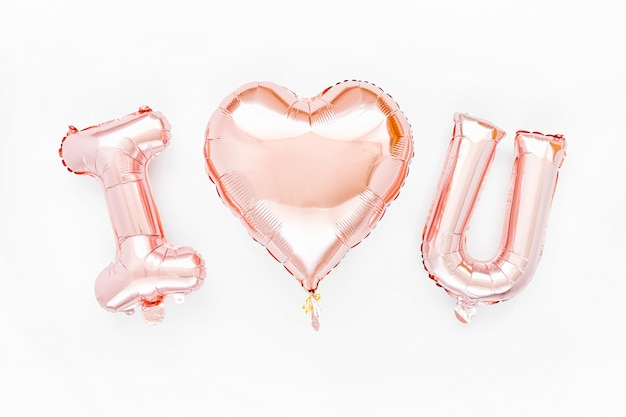 Blassrosa folienballons in form des wortes