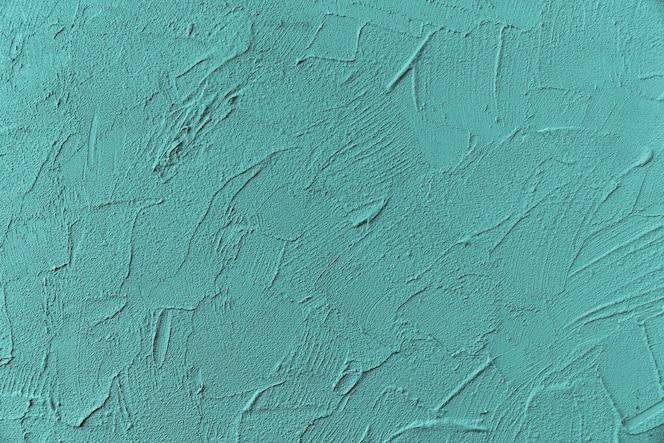 Blau lackierte raue Wandoberfläche