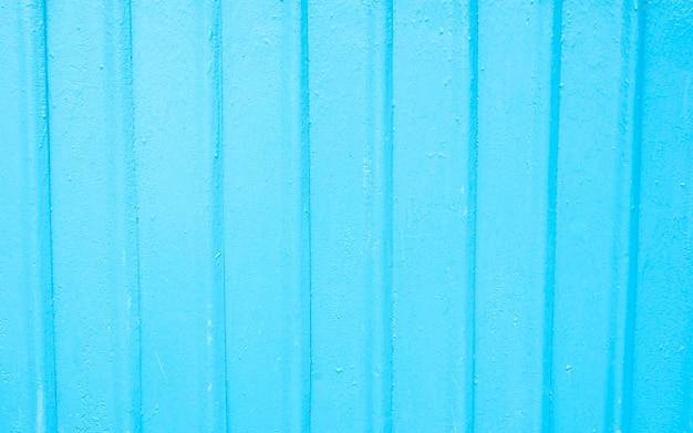 Blau lackierte zinkplatte mit kleinen wellenförmigen mustern und nahtlosem hintergrund