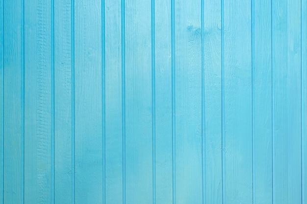Blau lackierter farbiger hölzerner plankenhintergrund nah oben