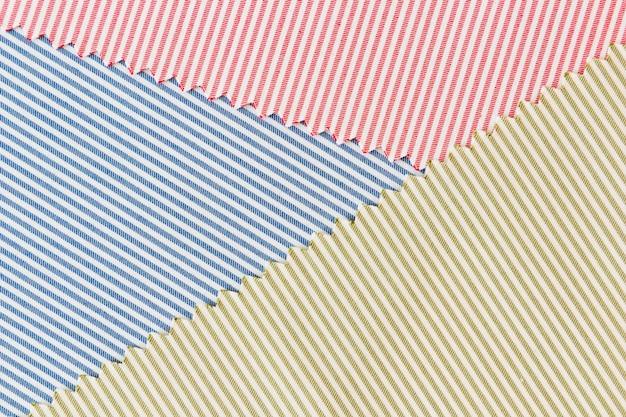 Blau; roter und grüner gebogener textilgewebehintergrund