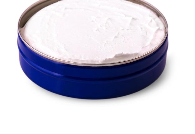 Blaue cremeform, geschlossen, weiß isoliert.