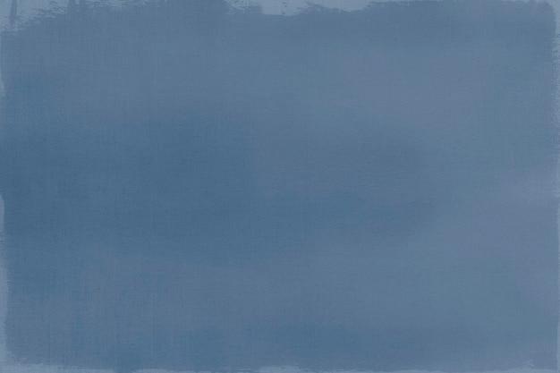 Blaue farbe auf einem strukturierten leinwandhintergrund