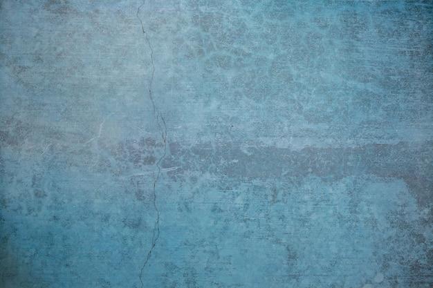 Blaue farbe der leeren schmutzbetonmauer für beschaffenheitshintergrund