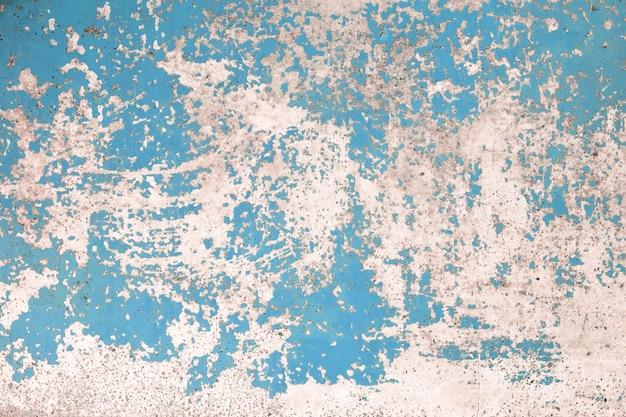 Blaue farbe der schmutzbetonmauer für beschaffenheitshintergrund