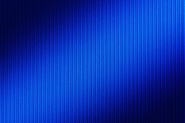 Blaue farbe des dekorativen hintergrundes, gestreifte beschaffenheitsdiagonalsteigung.