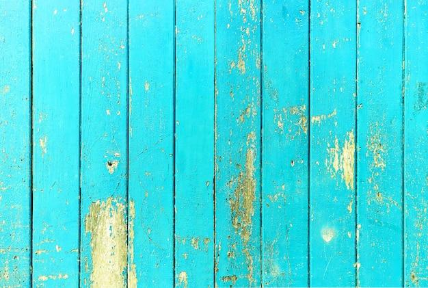 Blaue farbe des hölzernen brettes der weinlese malte hölzerne wand