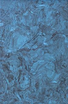Blaue keramikfliese mit rauem abstraktem steinoberflächenmuster