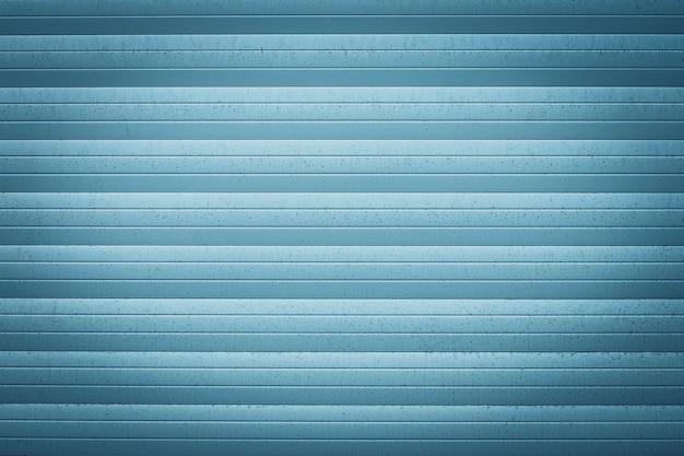 Blaue metalljalousie. textur der gewellten oberfläche.