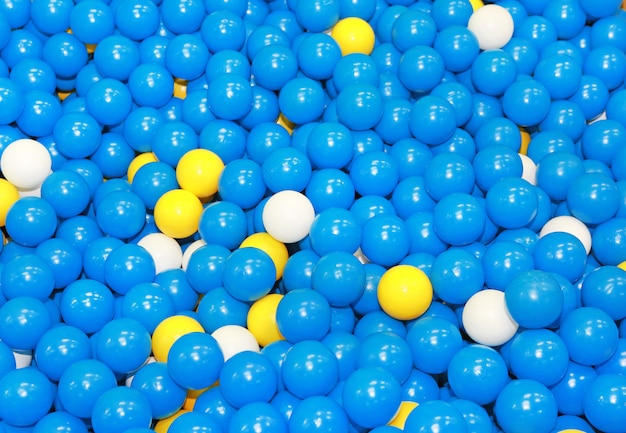Blaue plastikbälle mit etwas weiß und gelb für kinder.