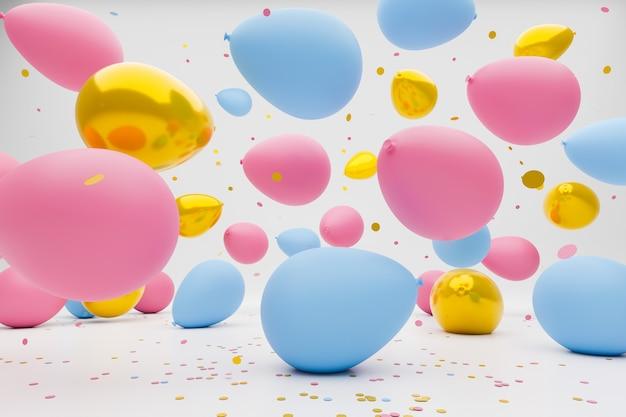 Blaue, rosa und goldfarbene ballons, die auf den boden fallen und hüpfen. Premium Fotos