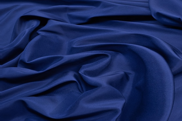 Blaue stoffoberfläche. wellenhintergrundbeschaffenheitshintergrund der kleidung