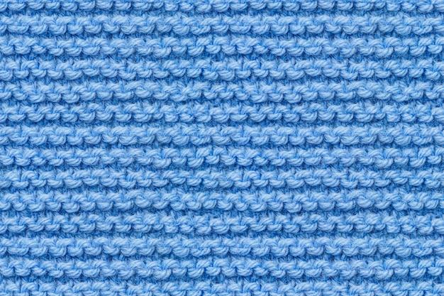 Blaue strickstoff-textur. stricken textur makro schnappschuss. blau gestrickt