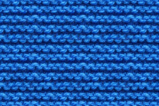Blaue strickstoff-textur. stricken textur makro schnappschuss. dunkelblau gestrickt