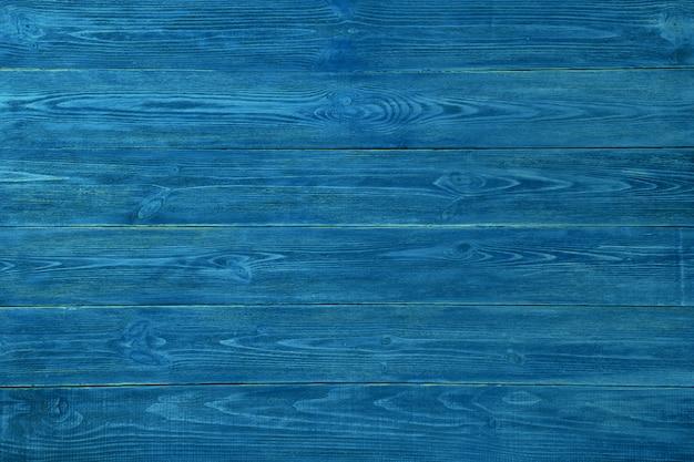 Blaue strukturierte bretter. hintergrund von blauen strukturierten brettern. blauer strukturierter hölzerner hintergrund